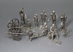 Seven various silvered-metal character figures, some with accessories.