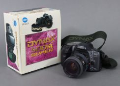 """A Minolta """"Dynax 500si Super"""" camera, with 55mm zoom lens, boxed."""