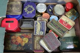 Thirty-nine various advertising tins.
