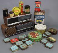A Grundig radio receiver (model RF420); a Philips radio receiver; & various advertising tins.
