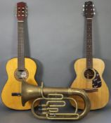 A Fender six-string acoustic guitar, another acoustic guitar (one with case); & a brass Euphonium (l