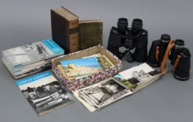 Two pairs of binoculars; together with various loose postcards, family photographs, etc.