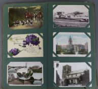 An album of approximately two hundred postcards, early-mid 20th century – British views, portrait