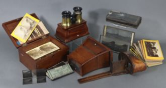 Four stereo-card viewers; a stereo-card storage box; & a quantity of stereoview cards.