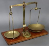 A late 19th/early 20th century large brass beam scale by W.A. Webb Ltd. of London mounted on