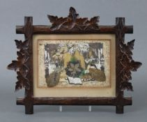 A Victorian Valentine's day card in carved wooden frame with foliate border.