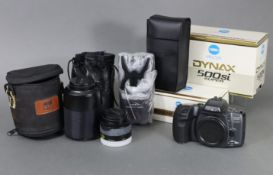 """A Minolta """"Dynax 500si Super"""" camera, boxed; together with two Minolta lenses & a ditto """"Program"""