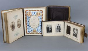 Three Victorian leather-bound family photograph albums containing a total of one hundred & five