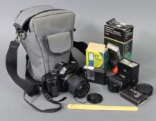 """A Yashica """"108"""" camera with a 52mm lens & various other accessories."""