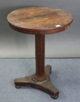 A 19th century rosewood occasional table with circular top & on octagonal centre column & triform
