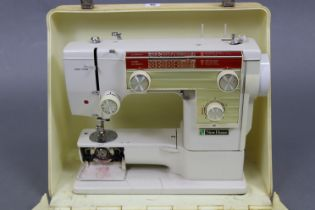 A New Home electric sewing machine with case.