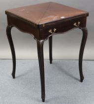 An Edwardian mahogany envelope-top card table inset green baize, fitted frieze drawer, & on carved