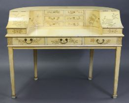A Carlton House-type cream finish wooden desk, fitted with an arrangement of small drawers &