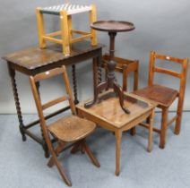 A 1930's oak rectangular occasional table on barley-twist legs & turned feet with plain