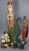 """A painted & carved wooden Buddha ornament, 22"""" high; a pair of temple-dog ornaments, 10"""" high; &"""