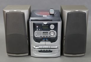 A Geneus music centre hi/fi system with a remote control; & a pair of Kenwood speakers, w.o.