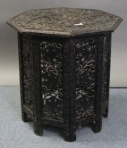 A late 19th/early 20th century eastern hardwood occasional table with carved foliate design to the
