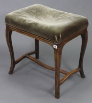 An Edwardian beech piano stool, with padded seat & on slender cabriole legs with plain stretchers,