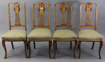 A set of four Edwardian inlaid-beech splat-back dining chairs with padded seats, & on slender
