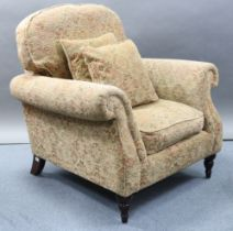A Parker-Knoll armchair upholstered multi-coloured geometric material, & on short turned legs.
