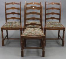 A set of four ladder-back dining chairs with padded drop-in seats & on turned legs with plain