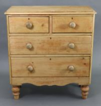 A pine chest fitted two short & two long graduated drawers with turned knob handles, & on short