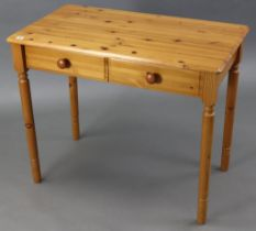 """A pine side table fitted two frieze drawers, & on turned legs, 35"""" wide; & a laminate rectangular"""