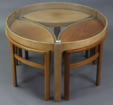 A Nathan nest of four occasional tables (three navette shaped tables under one), the larger circular
