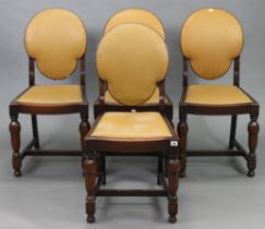 A Set of four Hodkinson's of Warrington oak dining chairs with padded seats & backs, & on bulbous-