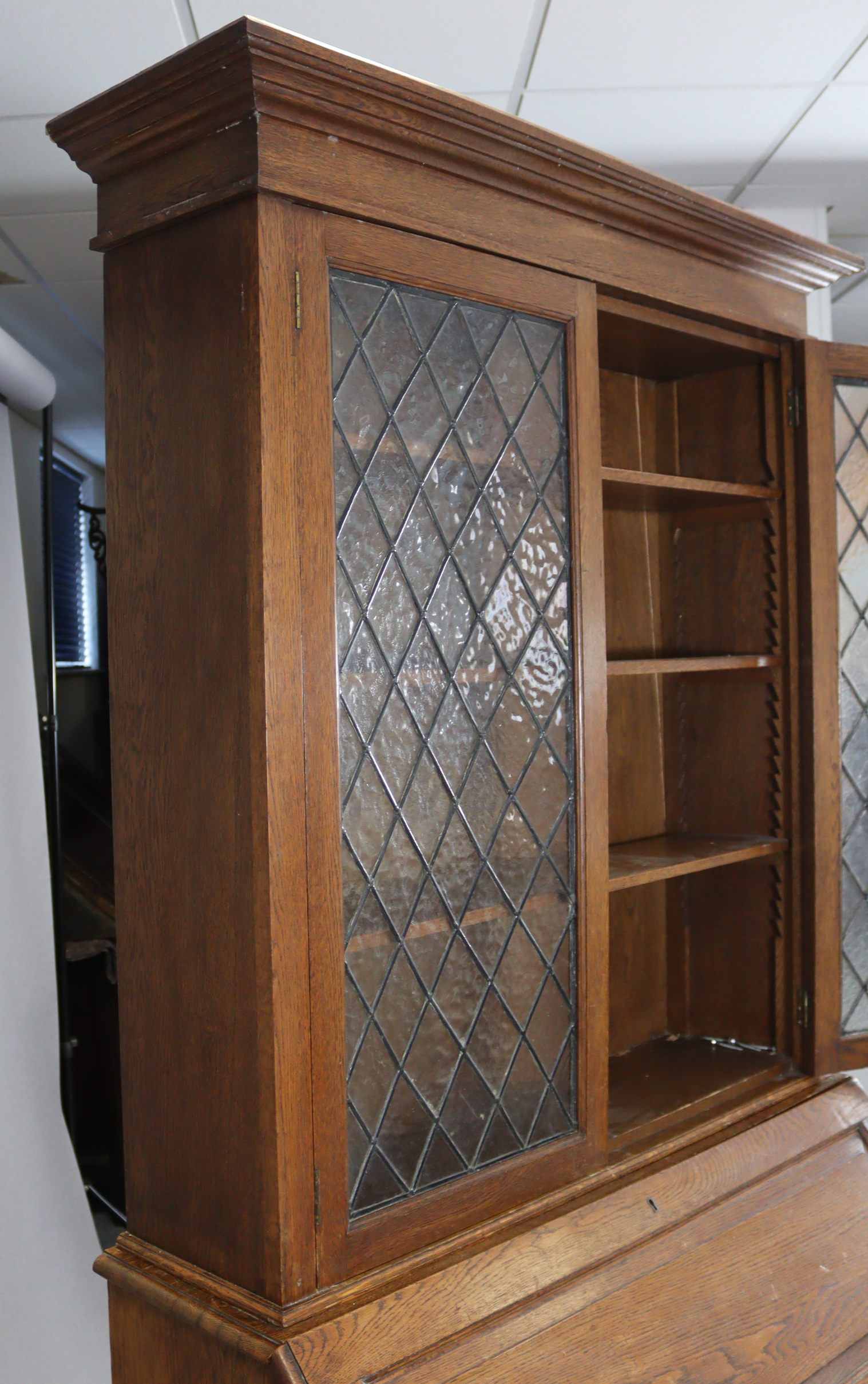 A late 19th/early 20th century oak bureau-bookcase with moulded cornice above a pair of leaded - Image 5 of 7