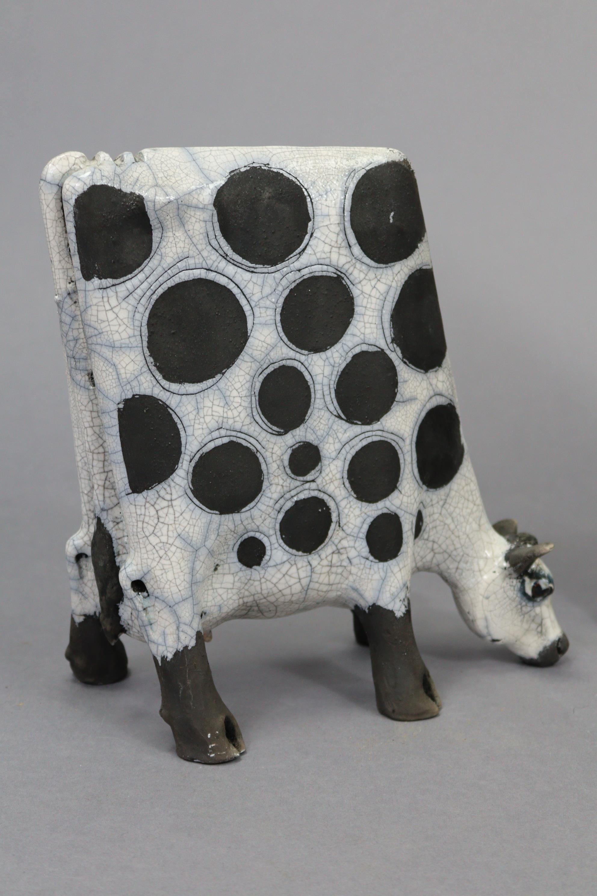 """A mantel clock in black glazed pottery case, 19¼"""" high; a contemporary pottery model of a cow, - Image 3 of 9"""