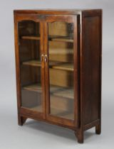 """An oak bookcase fitted three shelves enclosed by a pair of glazed doors, 29½"""" wide x 42½"""" high."""