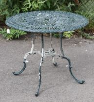 """A green painted aluminium patio table with pierced circular top, & on four shaped legs, 33"""" diameter"""