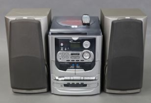 """A Rotel compact disc player with remote control; a Sony Digital radio receiver; a Yamaha """"Active"""