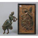 "A bronzed metal plaque depicting Diana the Huntress, 19¾"" x 11"", framed; & a cast-iron ornament"