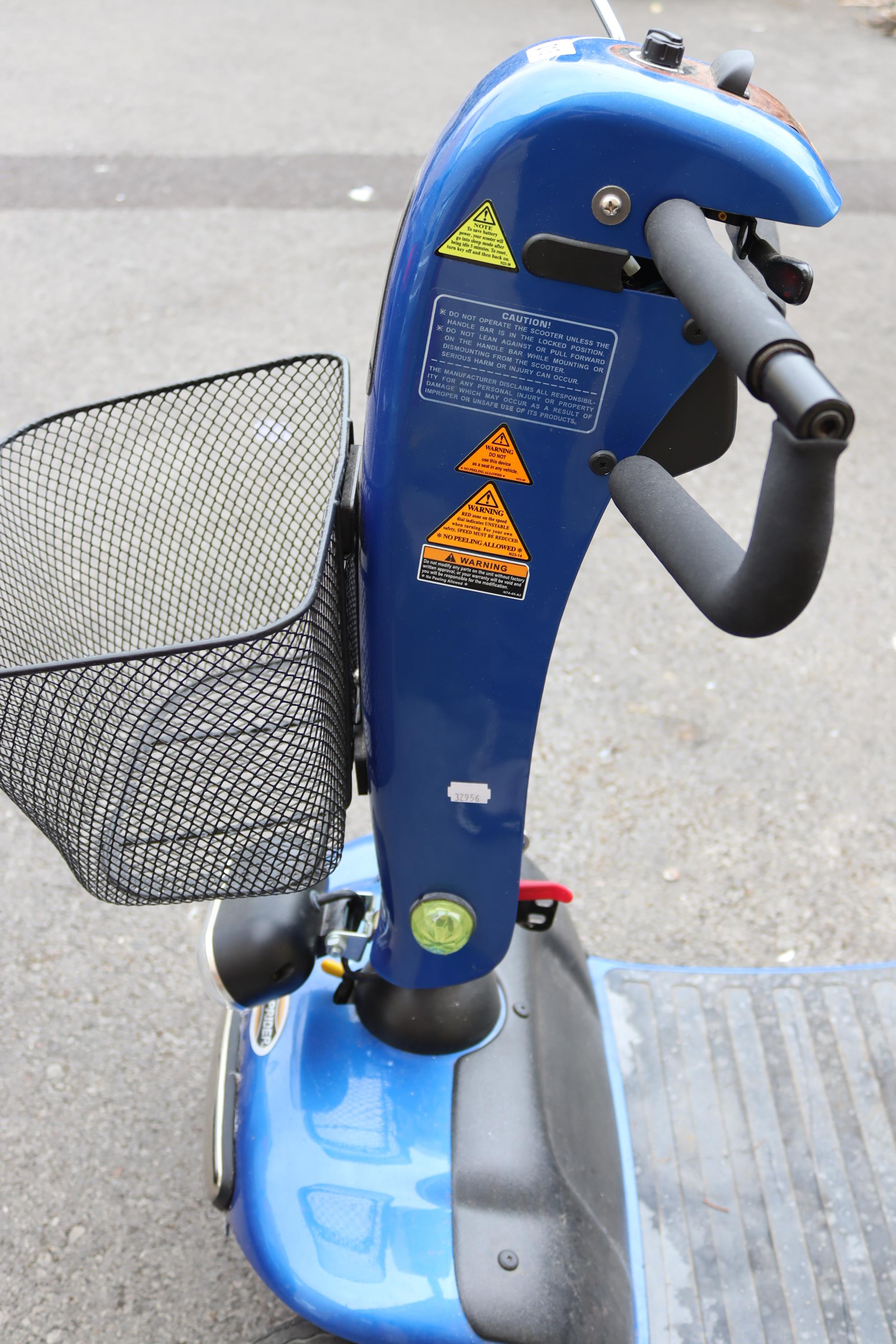 A Shoprider mobility scooter with battery, charger, & key. - Image 4 of 8