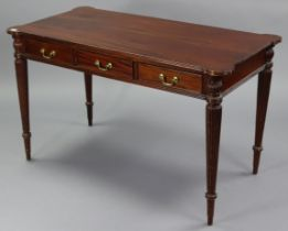 A 19th century-style mahogany side table fitted three frieze drawers, & on four turned & fluted