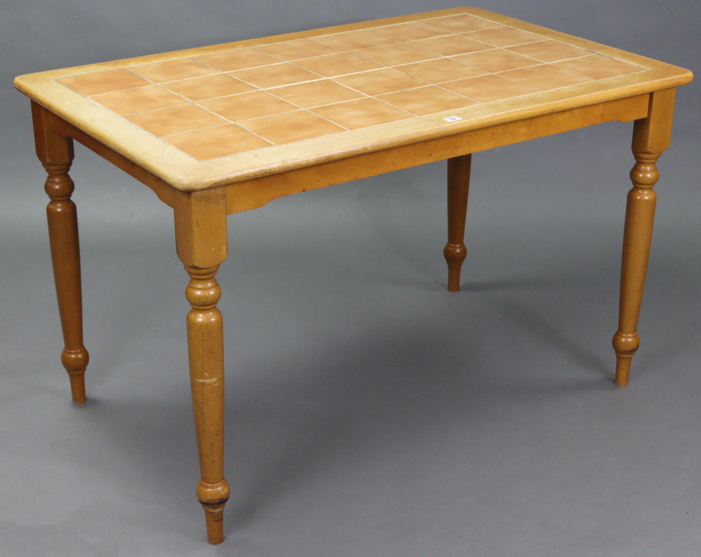 "A beech rectangular tile-top kitchen table on four turned legs, 47"" wide x 29½"" high x 29½"" deep."