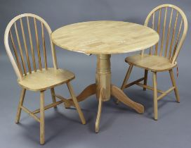 A maple-finish circular drop-leaf kitchen table on vase-turned centre column & four splay legs,