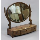 """A 19th century mahogany oval swing toilet glass fitted three drawers to the bow-front box base, 23½"""""""