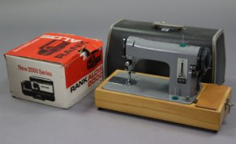 """An Alfa standard electric sewing machine with case; a Sankyo movie camera; a ditto """"Dualux 1000"""""""