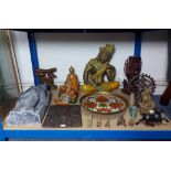 """A large glazed pottery buddha figure, 15¾"""" high; two other buddha figures; & various other eastern"""
