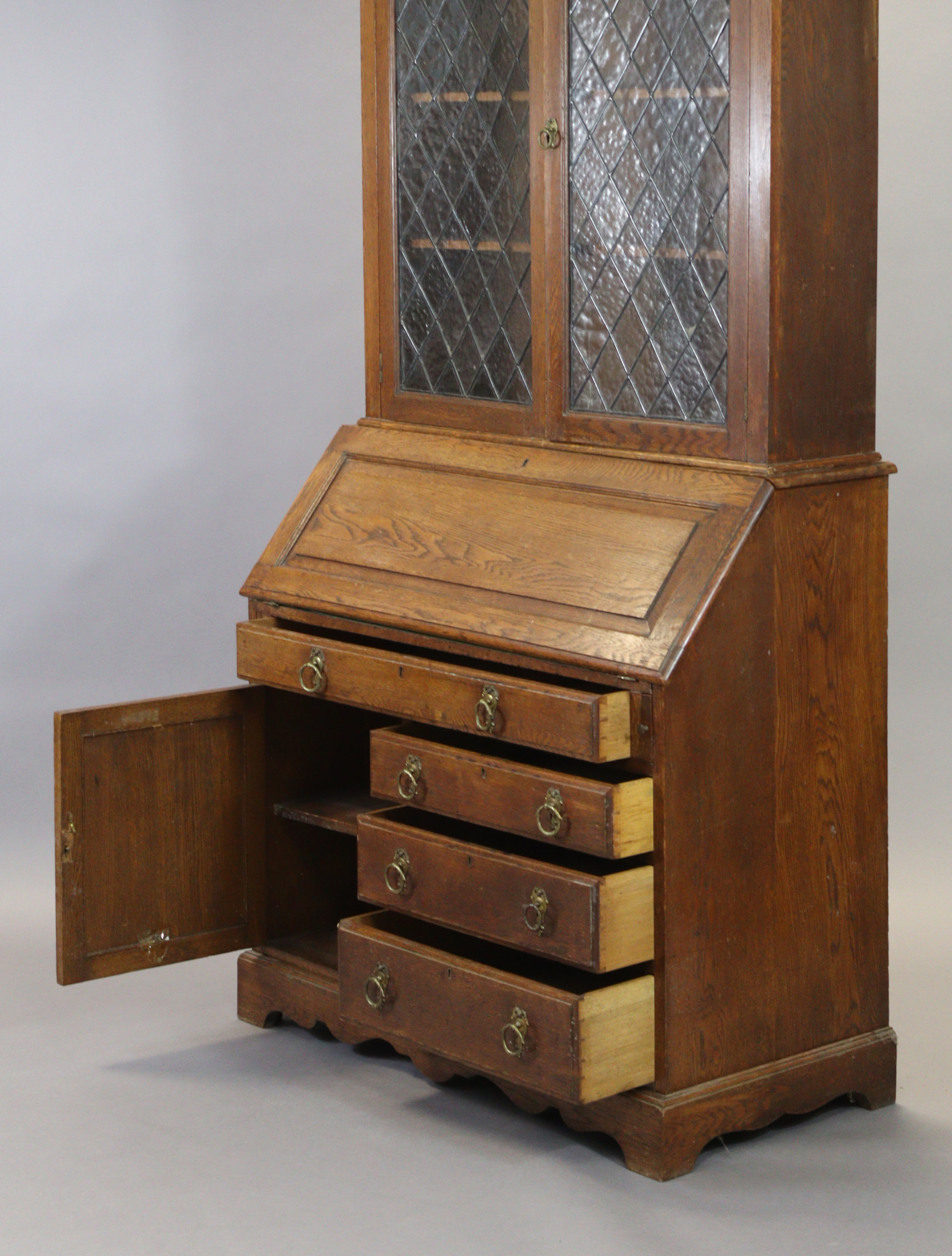 A late 19th/early 20th century oak bureau-bookcase with moulded cornice above a pair of leaded - Image 2 of 7