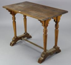 An oak kitchen table with rectangular top, & on a pair of turned supports to either end joined by