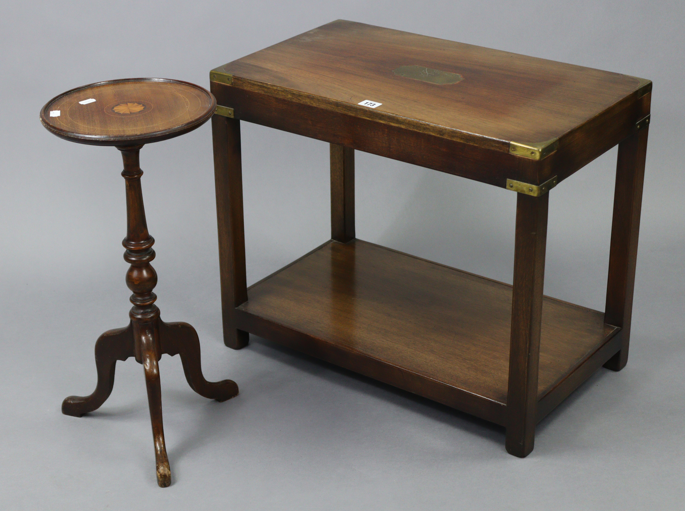 A reproduction brass-mounted mahogany campaign-style rectangular two tier coffee table on square