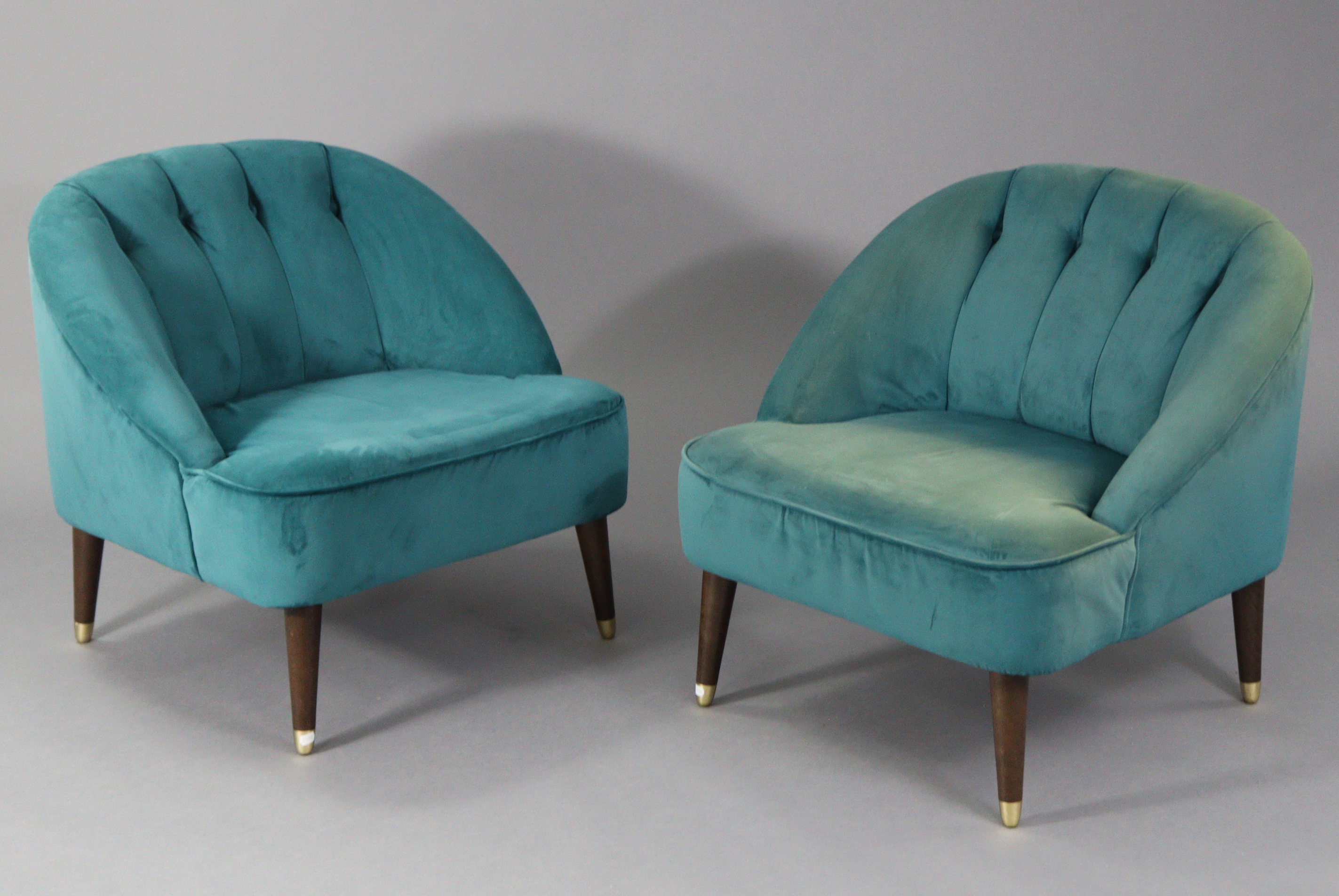 A pair of tub-shaped easy chairs each with buttoned back & sprung seat upholstered turquoise velour,