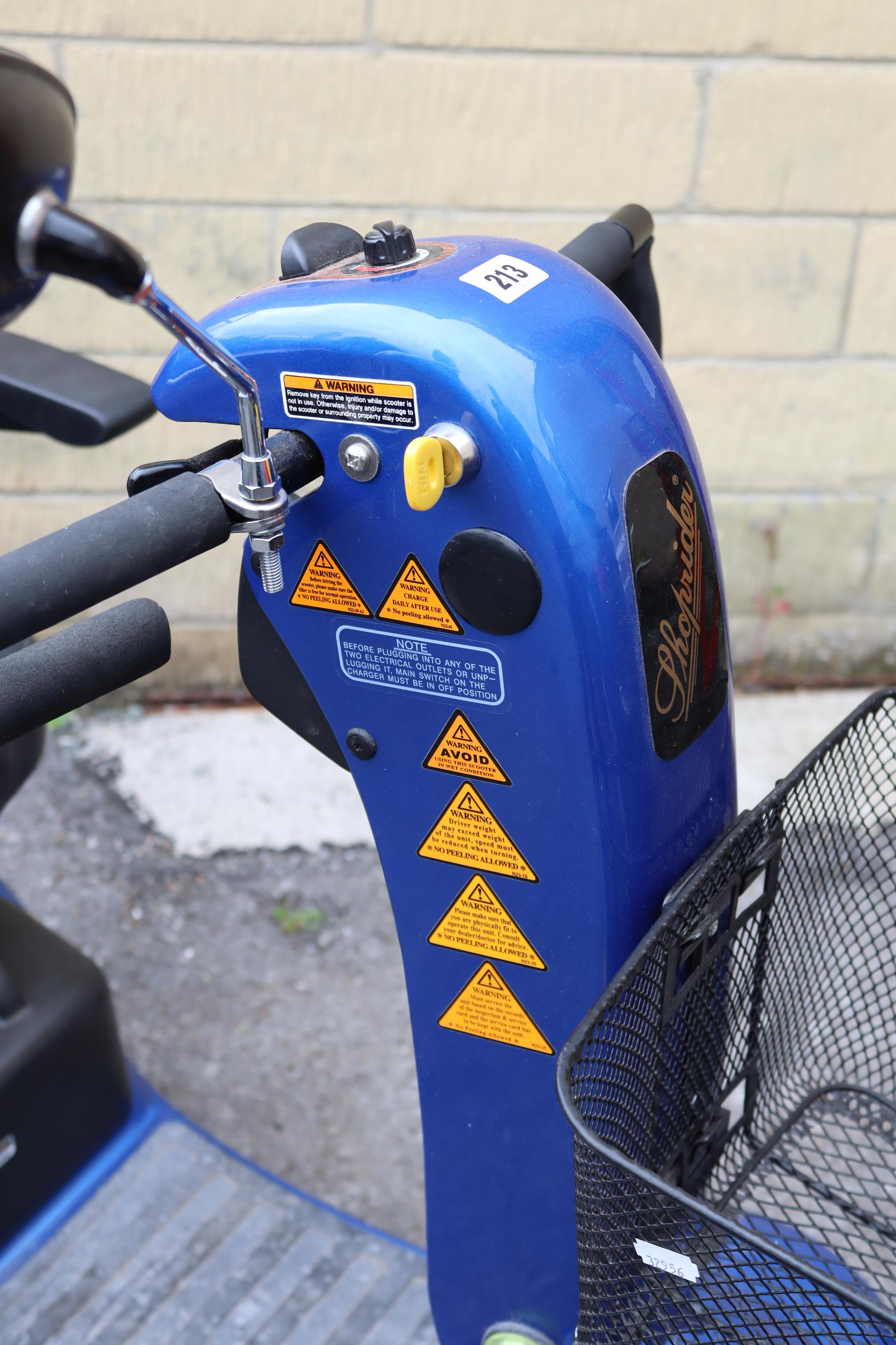 A Shoprider mobility scooter with battery, charger, & key. - Image 2 of 8