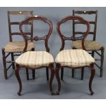 A pair of Victorian-style balloon-back dining chairs with padded seats, & on slender cabriole