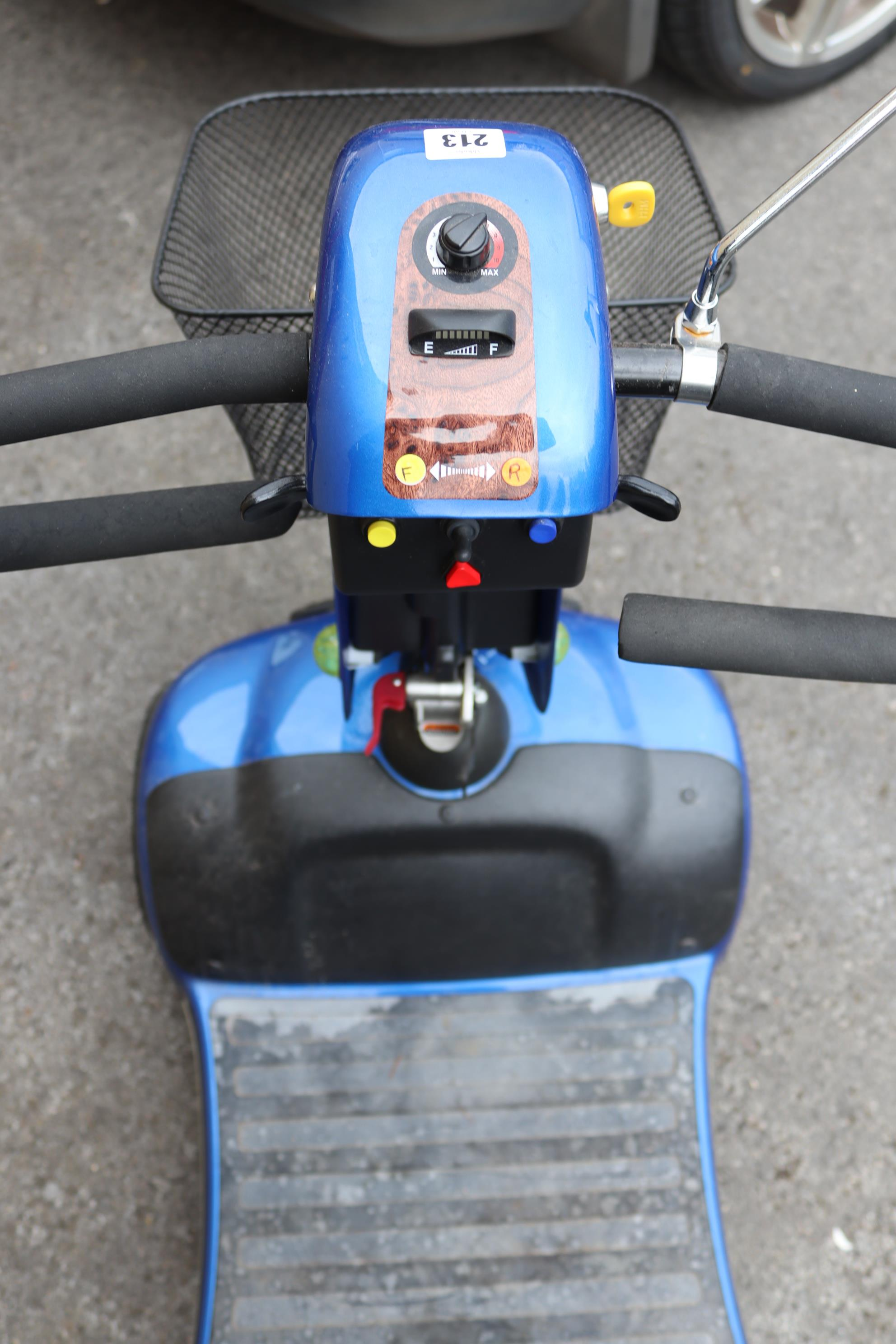 A Shoprider mobility scooter with battery, charger, & key. - Image 5 of 8