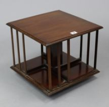 """A mahogany square revolving table-top bookcase, 14½"""" wide x 13"""" high; & a brass-finish foldaway"""